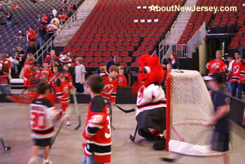 Young New Jersey Devils Fans Playing Hockey
